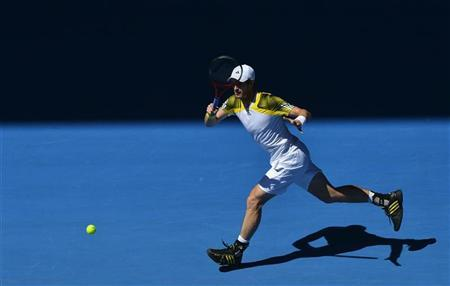 Andy Murray of Britain hits a return to Robin Haase of Netherlands during their men's singles match at the Australian Open tennis tournament in Melbourne January 15, 2013. REUTERS/Toby Melville