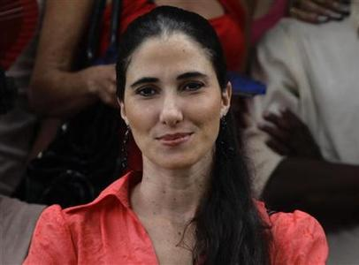 Cuban dissident blogger Yoani Sanchez attends a wedding in Havana, in this file picture taken August 13, 2011. REUTERS/Desmond Boylan/Files