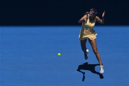Victoria Azarenka of Belarus hits a return to Monica Niculescu of Romania during their women's singles match at the Australian Open tennis tournament in Melbourne January 15, 2013. REUTERS/Toby Melville