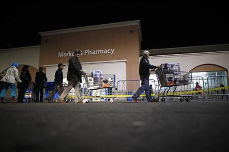 People push loaded shopping carts at a Walmart store, on Thanksgiving day in North Bergan, New Jersey November 22, 2012. REUTERS/Eric Thayer