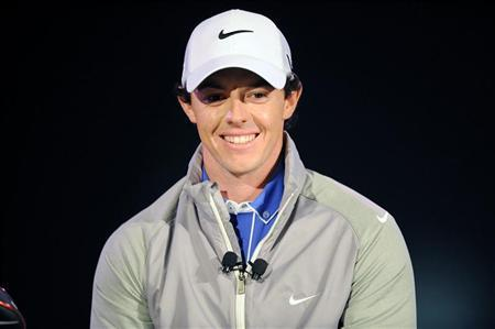 Rory McIlroy of Northern Ireland smiles during a presentation unveiling him as Nike's new ambassador in Abu Dhabi January 14, 2013. World golf number one McIlroy wants Ireland's Paul McGinley to be Europe's 2014 Ryder Cup skipper, rather than Colin Montgomerie, with a decision on the captaincy due on Tuesday. REUTERS/Ben Job