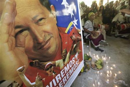 A poster of Venezuela's President Hugo Chavez is seen during a Afro-Cuban Santeria ceremony to pray for his recovery, in Havana January 10, 2013. REUTERS/Enrique De La Osa (CUBA - Tags: POLITICS RELIGION)
