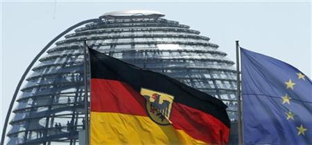 The German and the European Union flags are pictured in front of the cupola on top of the Reichstag building in Berlin May 23, 2012. REUTERS/Fabrizio Bensch (GERMANY - Tags: POLITICS)