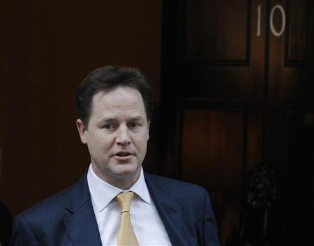 Britain's Deputy Prime Minister Nick Clegg leaves Downing Street in London November 29, 2012. REUTERS/Luke MacGregor