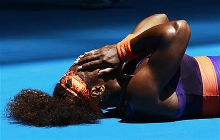 Serena Williams of the U.S. lies on the floor after falling over during her women's singles match agasin Edina Gallovits-Hall of Romania at the Australian Open tennis tournament in Melbourne, January 15, 2013. REUTERS/Daniel Munoz