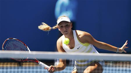 Donna Vekic of Croatia hits a return to Andrea Hlavackova of Czech Republic during their women's singles match at the Australian Open tennis tournament in Melbourne January 15, 2013. REUTERS/Tim Wimborne
