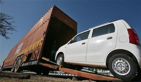 A worker unloads an A-Star car from a container at a Maruti Suzuki stockyard on the outskirts of Jammu 23, 2012. REUTERS/Mukesh Gupta/Files