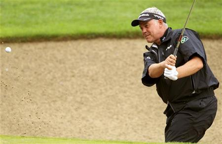 Darren Clarke of Northern Ireland hits out of the bunker onto the 9th green during the first round of the European Masters golf tournament in the Swiss mountain resort of Crans-Montana August 30, 2012. REUTERS/Arnd Wiegmann