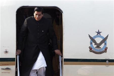 Pakistan's Prime Minister Raja Pervez Ashraf arrives at Vientiane airport November 4, 2012. REUTERS/Sukree Sukplang