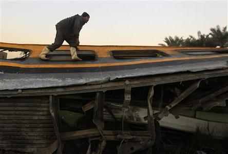 A man inspects the wreckage of a military train crash in the Giza neighbourhood of Badrashin, about 40 km (25 miles) west of Cairo, January 15, 2013. REUTERS/Mohamed Abd El Ghany