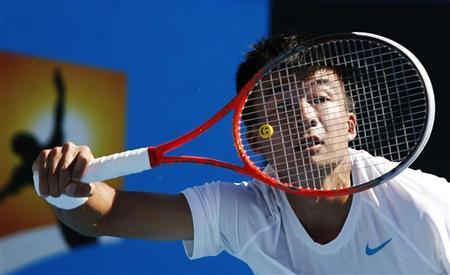 Wu Di of China hits a return to Ivan Dodig of Croatia during their men's singles match at the Australian Open tennis tournament in Melbourne January 15, 2013. REUTERS/David Gray