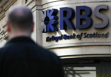 A man passes a Royal Bank of Scotland branch, in central London February 21, 2009. REUTERS/Luke MacGregor/Files