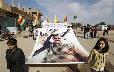 Syrian Kurds demonstrators hold a giant portrait of jailed Kurdistan Workers Party (PKK) leader Abdullah Ocalan during a protest in Derik, Hasakah November 1, 2012. REUTERS/Thaier al-Sudani