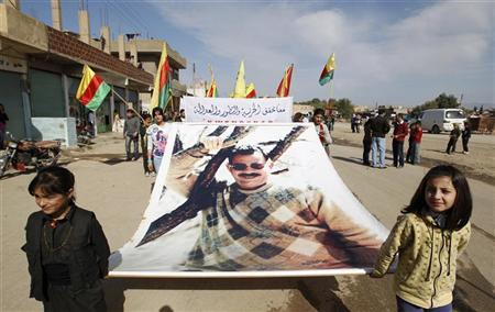 Syrian Kurds demonstrators hold a giant portrait of jailed Kurdistan Workers Party (PKK) leader Abdullah Ocalan during a protest in Derik, Hasakah November 1, 2012. REUTERS/Thaier al-Sudani