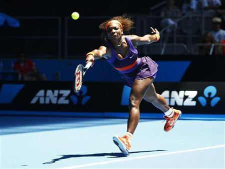 Serena Williams of the U.S. hits a return to Edina Gallovits-Hall of Romania during their women's singles match at the Australian Open tennis tournament in Melbourne, January 15, 2013. REUTERS/Daniel Munoz