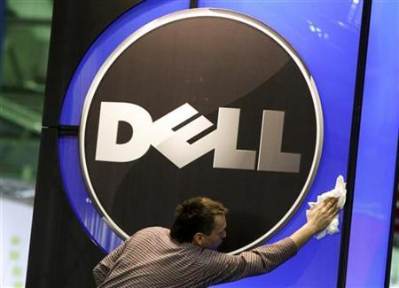 A man wipes the logo of the Dell IT firm at the CeBIT exhibition centre in Hannover February 28, 2010. The world's largest IT fair CeBIT opens its doors on March 2 and runs through March 6. REUTERS/Thomas Peter (GERMANY - Tags: SCI TECH BUSINESS)