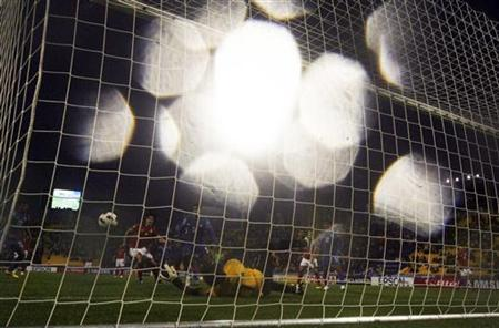 India's goalkeeper Subrata Paul (C) concedes the first goal by South Korea's Ji Dong-won during their 2011 Asian Cup Group C soccer match at Al Gharafa stadium in Doha January 18, 2011. REUTERS/Mohammed Dabbous/Files