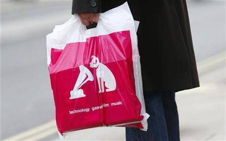 A shopper carries a bag from an HMV shop on Oxford Street in London January 12, 2013. REUTERS/Suzanne Plunkett