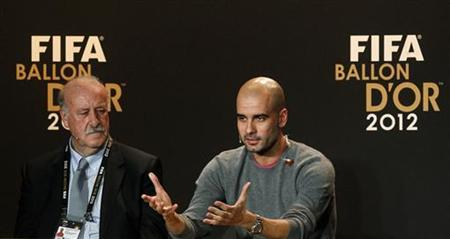 Men's Coach of the Year nominees Vicente del Bosque of Spain and his compatriot Pep Guardiola (R) address a news conference before the FIFA Ballon d'Or 2012 Gala at the Kongresshaus in Zurich January 7, 2013. REUTERS/Arnd Wiegmann