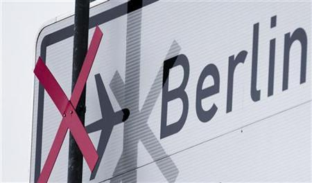 A pictogram of a plane is crossed out at the motorway traffic sign denoting the exit to the Berlin Brandenburg international airport Willy Brandt (BER) in Schoenefeld outside Berlin January 11, 2013. REUTERS/Thomas Peter (GERMANY - Tags: TRAVEL TRANSPORT)