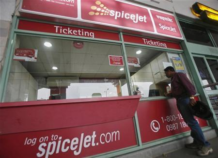 A passenger stands outside the SpiceJet Airlines ticket counter at the domestic airport on the outskirts of Agartala, capital of India's northeastern state of Tripura November 26, 2012. REUTERS/Jayanta Dey