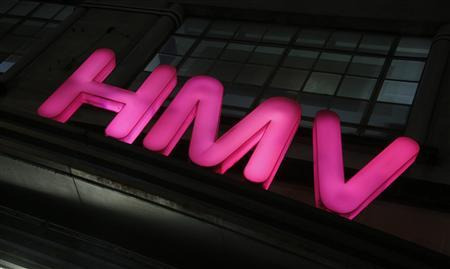 The logo of British music retail chain HMV is seen lit above its branch on Oxford Street in London January 14, 2013. Music and DVD retailer HMV may announce as soon as Monday that it will call in the administrators, according to a source close to the company and media reports, bringing the curtain down on one of Britain's best-known high street stores. REUTERS/Chris Helgren