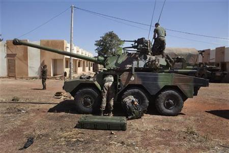 French soldiers arrange equipment in a tank at a Malian air base in Bamako January 15, 2013. REUTERS/Joe Penney
