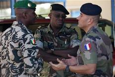 A French army officer (R) talks to his Malian and Senegalese army counterparts outside where a meeting is taking place for the intervention force provided by the ECOWAS grouping of West African states, in Bamako January 15, 2013. REUTERS/Joe Penney