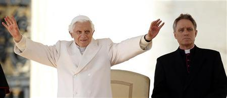 Pope Benedict XVI waves next his personal secretary Georg Ganswein during his weekly audience in Saint Peter's Square at the Vatican March 7, 2012. REUTERS/Max Rossi