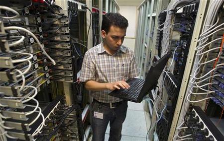 A computer engineer checks equipment at an internet service provider in Tehran February 15, 2011. REUTERS/Caren Firouz/Files