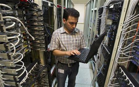 A computer engineer checks equipment at an internet service provider in Tehran February 15, 2011. REUTERS/Caren Firouz/Files