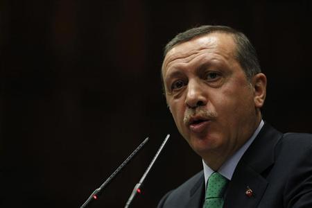Turkey's Prime Minister Tayyip Erdogan addresses members of parliament from the ruling AK Party (AKP) during a meeting at the Turkish parliament in Ankara February 28, 2012. REUTERS/Umit Bektas