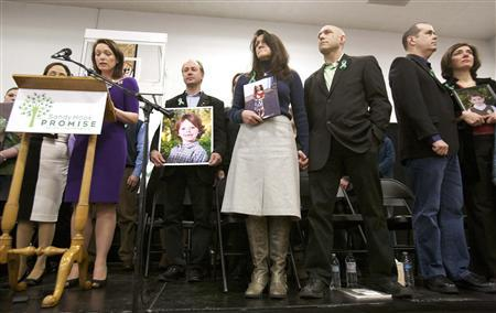 Family members of victims of the December 14, 2012 shooting at Sandy Hook Elementary School are seen on stage during the launch of The Sandy Hook Promise, a non-profit created in response to the shooting in Newtown, Connecticut January 14, 2013. REUTERS/Michelle McLoughlin