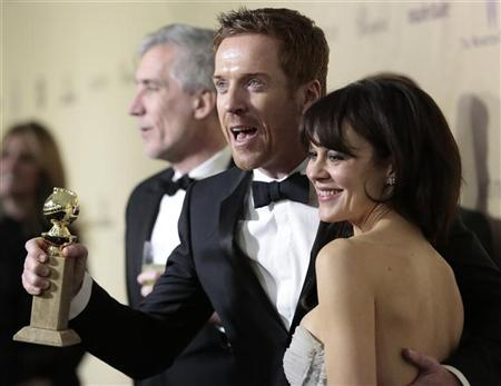 Damian Lewis, winner for Best Actor in a Television Series, Drama for ''Homeland,'' and his wife Helen McCrory arrive at the Weinstein Company after party following the 70th annual Golden Globe Awards in Beverly Hills, California, January 13, 2013. REUTERS/Jason Redmond