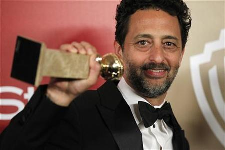Producer Grant Heslov holds his award for Best Motion Picture Drama for ''Argo'' at the InStyle/Warner Bros. after party following the 70th annual Golden Globe Awards in Beverly Hills, California January 13, 2013. REUTERS/Mario Anzuoni