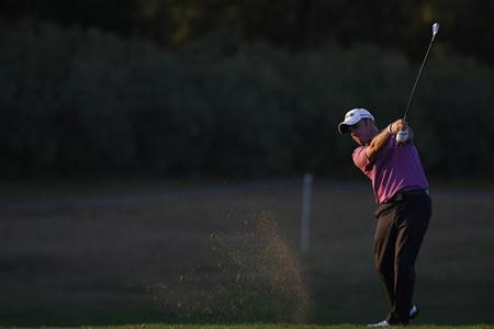 Paul McGinley of Ireland hits a shot on the 18th hole during the first round of the Portugal Masters golf tournament in Vilamoura October 14, 2010. REUTERS/Rafael Marchante