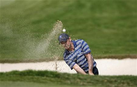 Europe's Paul McGinley of Ireland hits the ball from a bunker at the Royal Trophy golf tournament in Chonburi province, near Bangkok, January 11, 2009. REUTERS/Sukree Sukplang/Files