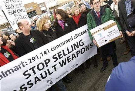 Protesters, including (front row L -R)Darren Wagner, Lori Haas, Roxanna Green and Pam Simon, gather to deliver a petition to Walmart during an anti-gun protest in Danbury, Connecticut January 15, 2013. REUTERS/ Michelle McLoughlin