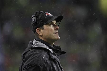 San Francisco 49ers head coach Jim Harbaugh looks on from the sidelines during the first quarter of their NFL football game against the Seattle Seahawks in Seattle, Washington, December 23, 2012. REUTERS/Robert Sorbo