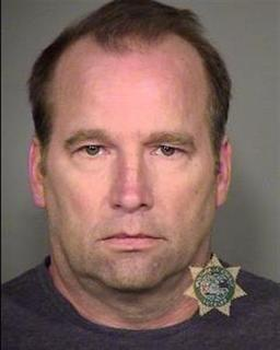 Oregon based research consultant, John Kinnucan, is pictured in this booking photo provided by Multnomah County Jail to Reuters on February 17, 2012. REUTERS/Multnomah County Jail/Handout