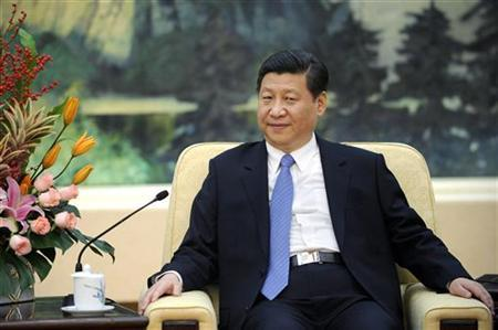 China's Communist Party chief Xi Jinping looks on during his meeting with U.N. General Assembly President Vuk Jeremic at the Great Hall of the People in Beijing December 27, 2012. REUTERS/Wang Zhao/Pool/Files