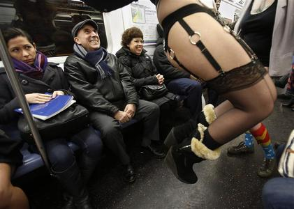 People watch as participants in the No Pants Subway Ride take the 6 train downtown in New York January 13, 2013. The event is an annual flash mob and occurs in different cities around the world, according to its organizers. REUTERS/Carlo Allegri