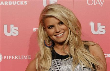 Actress and honoree Jessica Simpson poses at the US Weekly Hot Hollywood Style issue party in Hollywood, California, April 26, 2011. REUTERS/Mario Anzuoni