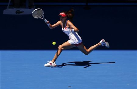 Agnieszka Radwanska of Poland hits a return to Irina-Camelia Begu of Romania during their women's singles match at the Australian Open tennis tournament in Melbourne, January 16, 2013. REUTERS/Daniel Munoz