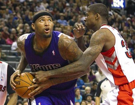 Sacramento Kings' DeMarcus Cousins drives to the basket past Toronto Raptors' Ed Davis (R) in the second half of their NBA basketball game in Toronto January 4, 2013. REUTERS/Fred Thornhill