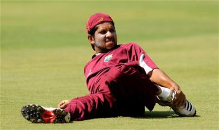 West Indies' Ramnaresh Sarwan stretches during a training session at the MA Chidambaram Stadium, Chennai March 15, 2011. REUTERS/Philip Brown/Files