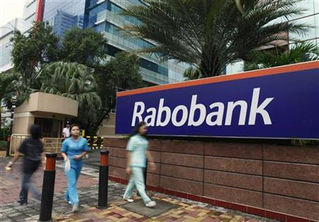 People walk in front of the Rabobank headquarters in Jakarta January 15, 2013. REUTERS/Beawiharta