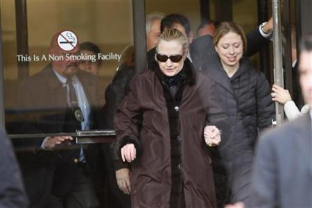 U.S. Secretary of State Hillary Clinton leaves New York Presbyterian Hospital with daughter, Chelsea (R), in New York, January 2, 2013. REUTERS/Joshua Lott