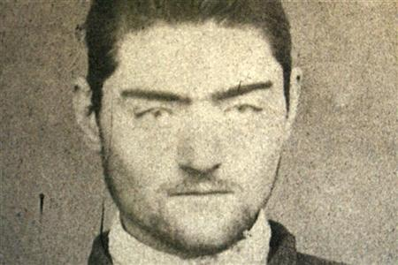 A photograph of a police mugshot of Ned Kelly, aged 16, at the Old Melbourne Gaol, March 13, 2008. Kelly, immortalised for using home-made armour in a final shoot-out with police, became a folk hero of Australia's colonial past with his gang's daring bank robberies and escapes. Kelly was hanged at the Melbourne Gaol in 1880. Australian archaeologists believe they have found the grave of Kelly on the site of an abandoned prison. REUTERS/Old Melbourne Gaol/Handout