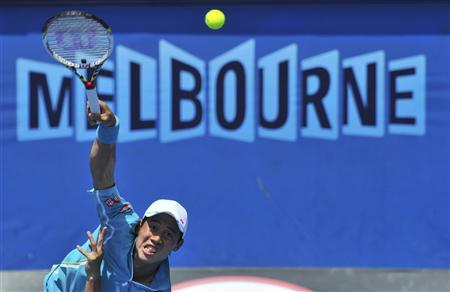 Kei Nishikori of Japan serves to Carlos Berlocq of Argentina during their men's singles match at the Australian Open tennis tournament in Melbourne January 16, 2013. REUTERS/Toby Melville